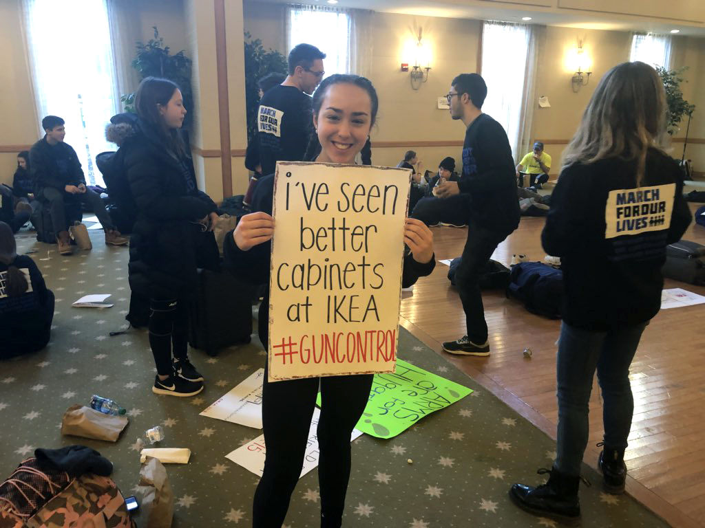 """We want to take fear out of the classroom,"" said Arielle Bauer, of Birmingham, Michigan, seen holding her sign in this photo. (WTOP/Melissa Howell)"