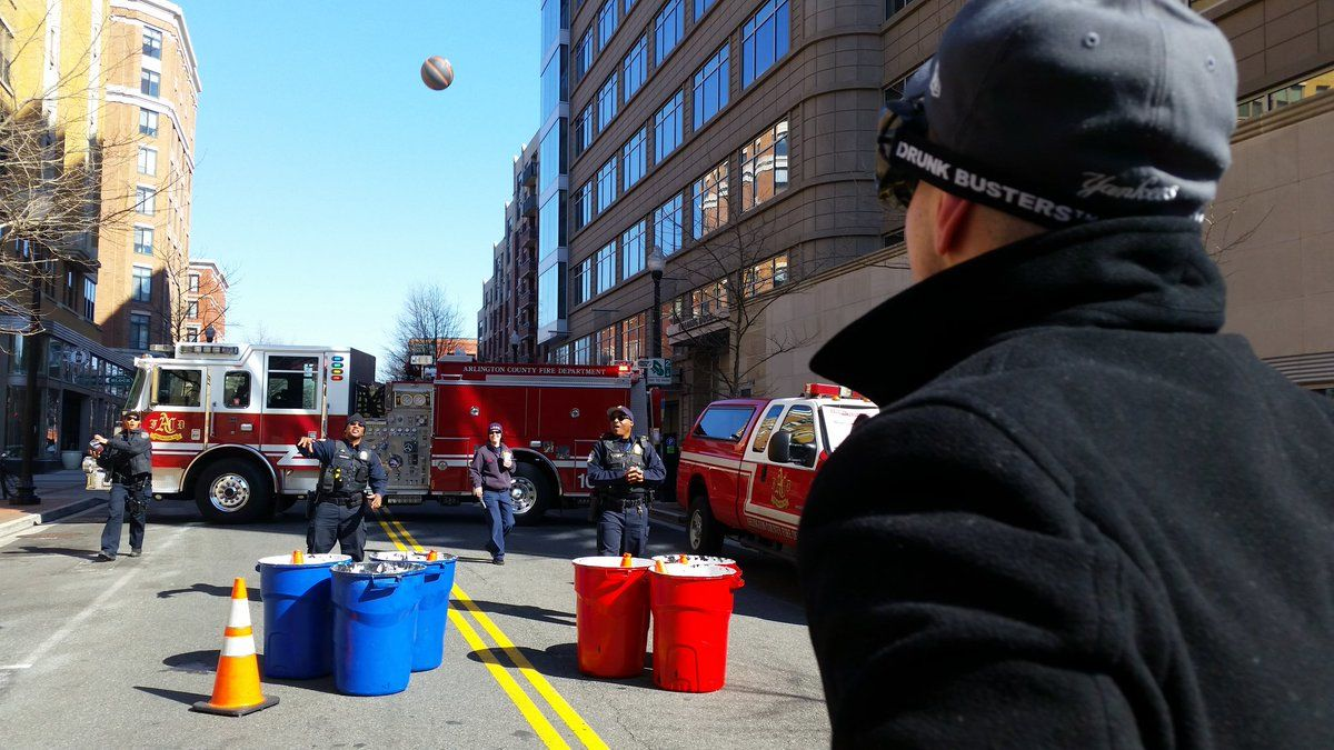 Police invited Clarendon Crawl attendees to their anti-drunken driving event where the street was shut down to make room for a giant beer pong game. Participants tried to get a basket while wearing goggles that simulate alcohol impairment. (WTOP/Kathy Stewart)