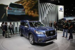 FILE- In this Nov. 29, 2017, file photo, the 2019 Subaru Ascent is displayed at the Los Angeles Auto Show in Los Angeles. The 2019 Subaru Ascent is a family-friendly three-row SUV with 5,000 pounds of towing capacity and up to eight USB ports to keep everyone's devices charged. (AP Photo/Jae C. Hong, File)
