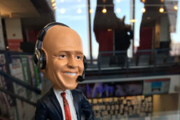 John Walton, the Caps radio play-by-play announcer, stopped by. He was immortalized as a bobble head for donors. (WTOP/Keara Dowd)