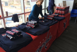 After donating blood, people were given a Caps shirt and a John Walton bobblehead. (WTOP/Keara Dowd)