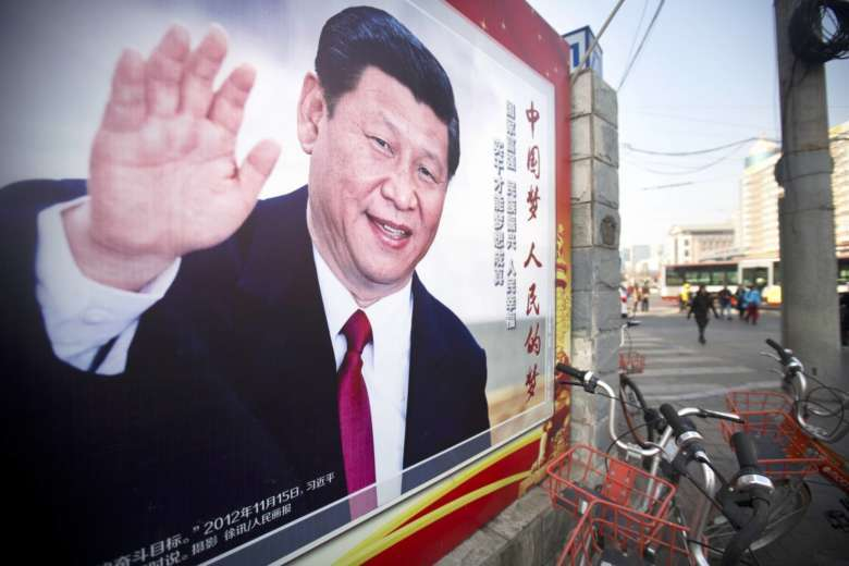 China defends scrapping of presidential term limit