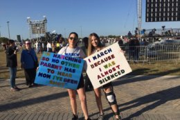 Stoneman Douglas junior Samantha Mayor, 17, was shot in the knee during shooting rampage on Feb. 14. Here she is with mom Ellyn at the March For Our Lives rally in Parkland. (Courtesy of Susannah Bryan on Twitter)