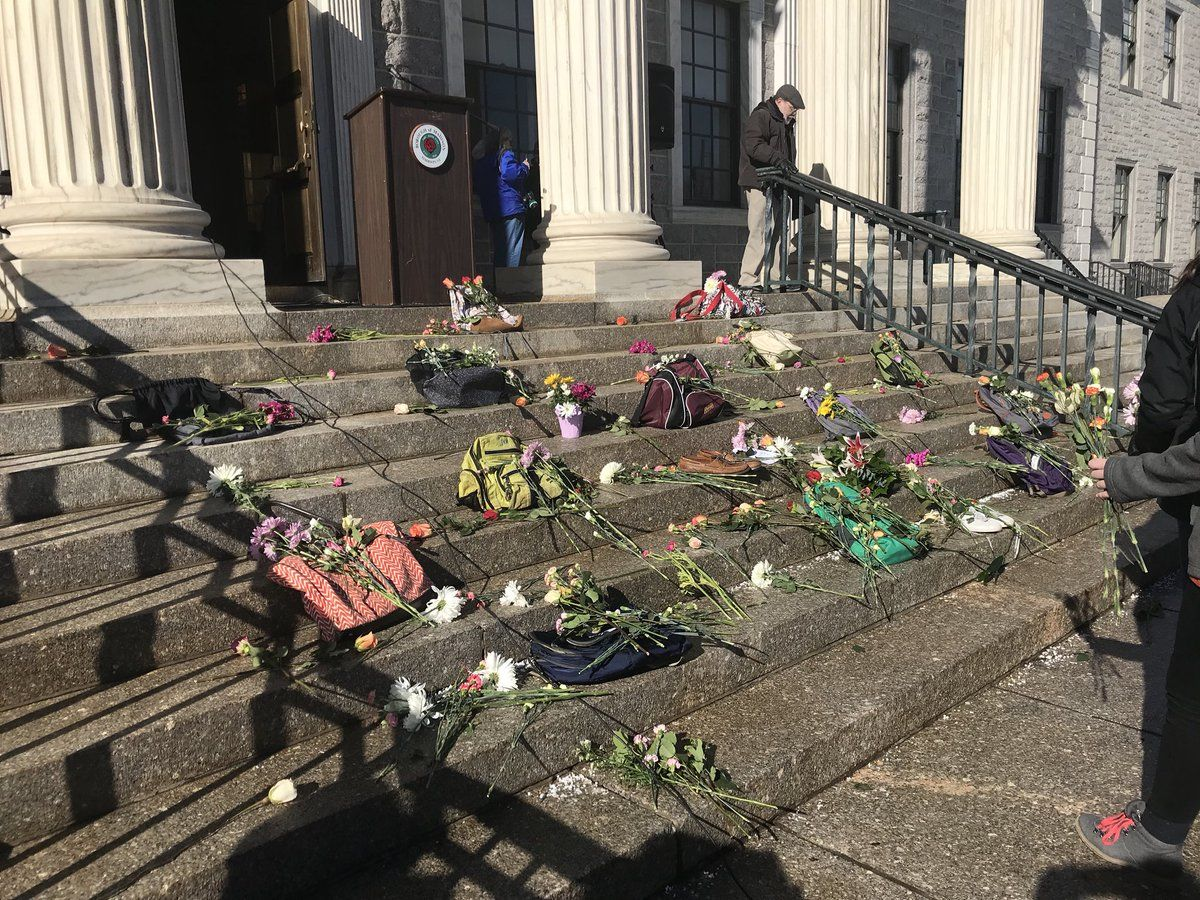Backpacks and pairs of shoes to represent the 17 victims of the Parkland school shooting are lined up on the Hartley Dodge Memorial building in Madison, N.J. (Courtesy of Kelly Dacey on Twitter)