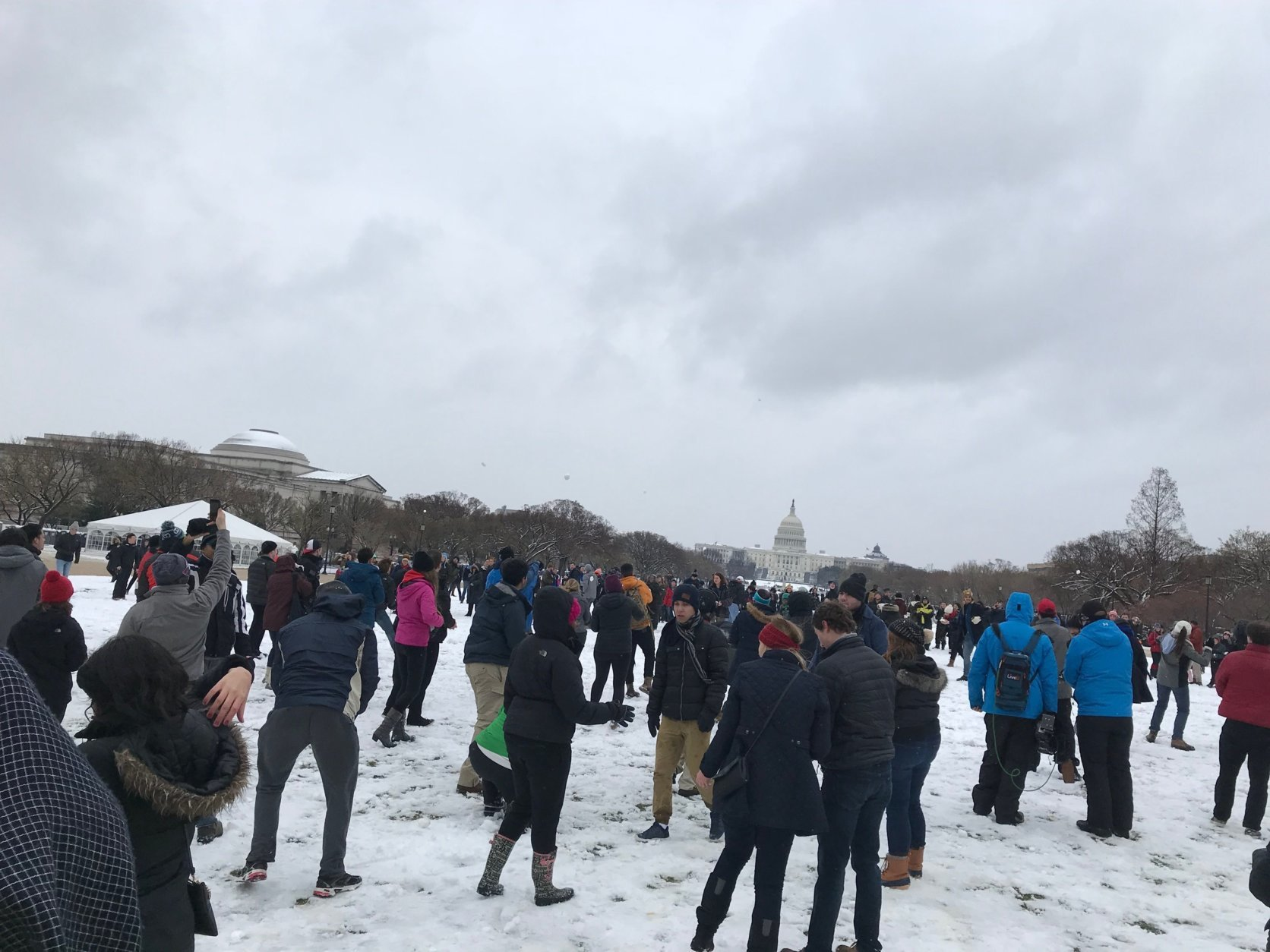 "A snowball battle takes place at the National Mall on Wednesday, March 21, 2018. It was organized through Facebook and bears the name ""Toby or Not Toby"" for the winter storm. (WTOP/Dick Uliano)"