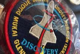 A patch from the Discovery mission, ion which John Glenn became the oldest man in space, from Glenn's estate. (WTOP/Kristi King)