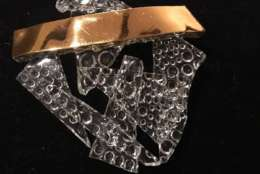 A brooch symbolizing 'breaking the glass ceiling,' from John Glenn's estate. (Courtesy Greater Washington Estate Services)