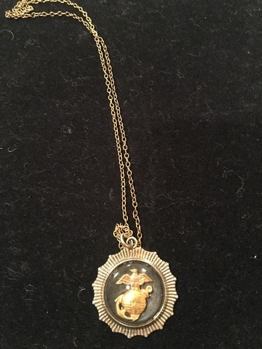 A sterling Marine Corps pendant from John Glenn's estate. (Courtesy Greater Washington Estate Services)