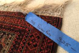A prayer rug at John Glenn's estate sale. (WTOP/Kristi King)