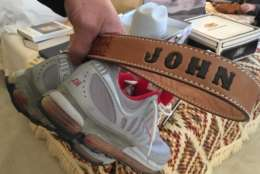 A belt and sneakers at John Glenn's estate sale. (WTOP/Kristi King)