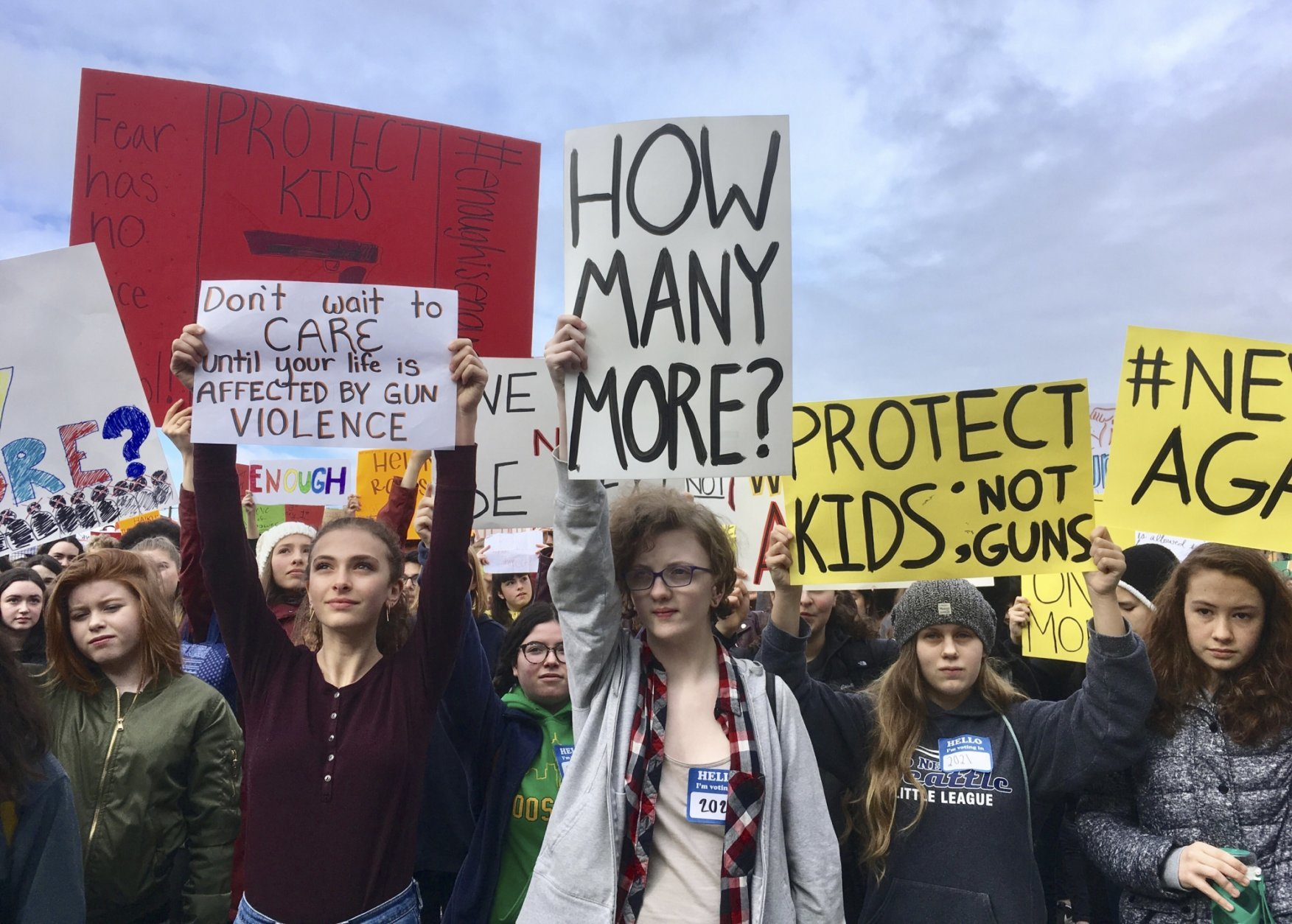 FILE - Students at Roosevelt High School take part in a protest against gun violence Wednesday, March 14, 2018, in Seattle. Politicians in Washington state are joining students who walked out of class to protest against gun violence. It was part of a nationwide school walkout that calls for stricter gun laws following the massacre of 17 people at a Florida high school. (AP Photo/Manuel Valdes)