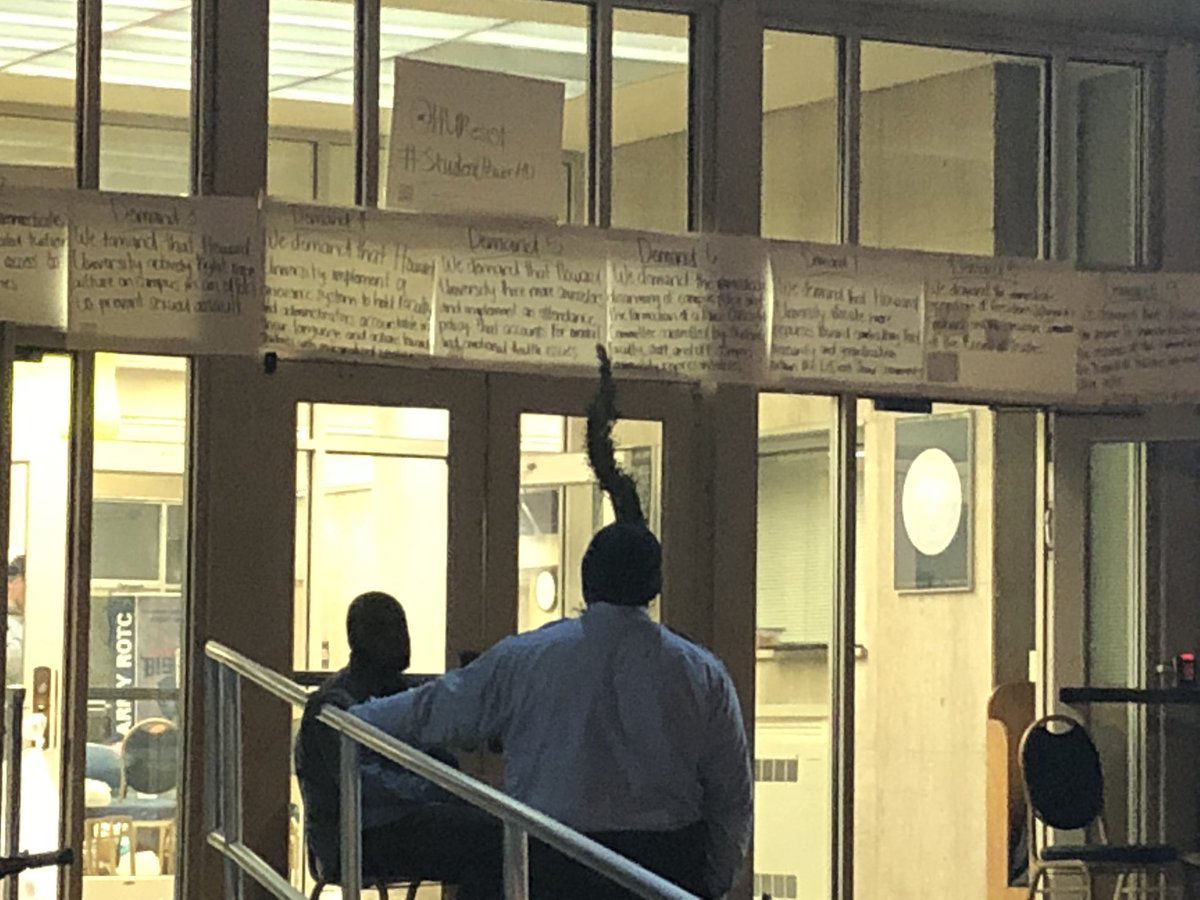 """Signs outside the sit-in at Howard University following the financial aid scandal. One sign read """"We love our university, we want our university to do better."""" (WTOP/Melissa Howell)"""