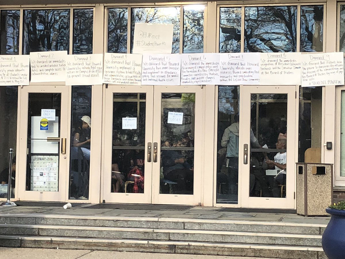 Signs put up by student protesters announce the administration building on Howard University's campus is closed. Students began a sit-in on Thursday night that closed the building. (WTOP/Melissa Howell)