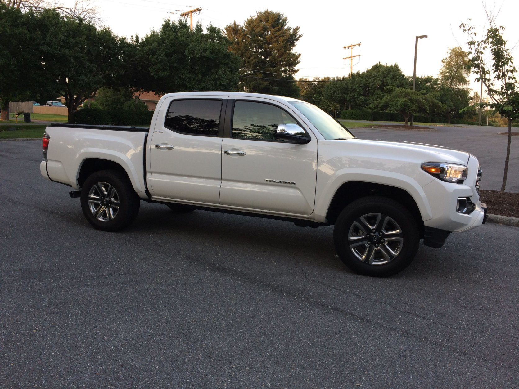 "The outside of the Tacoma Limited looks less ""off-road beast"" and more refined with body-colored bumpers, wheel arch extensions and a bunch of chrome trim pieces. (WTOP/Mike Parris)"