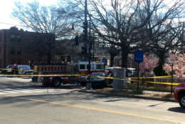A driver was killed and two others, including a pregnant woman, were taken to a hospital after a D.C. Fire and EMS truck collided with a car in Northeast on Friday afternoon. (WTOP/Mike Murillo)