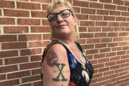 "This woman attending the ""Mysteries of Space and Sky"" UFO conference last October in Gambrills, Maryland, showed off her Ghostbusters and X-Files tattoos. (WTOP/Michelle Basch)"