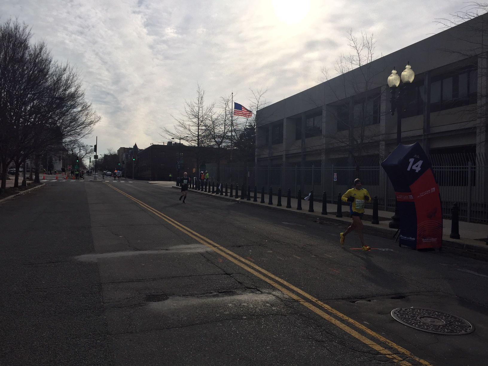 Rock 'n' Roll Marathon runners race down the street in Washington. (WTOP/John Domen)