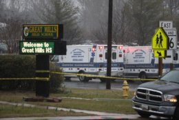 Deputies, federal agents and rescue personnel, converge on Great Mills High School, the scene of a shooting, Tuesday morning, March 20, 2018 in Great Mills, Md. (AP Photo/Alex Brandon)