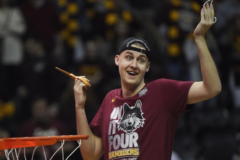f7ea4c699d75 Loyola-Chicago center Carson Shanks cuts the net after a regional final  NCAA college basketball tournament game against Kansas State.