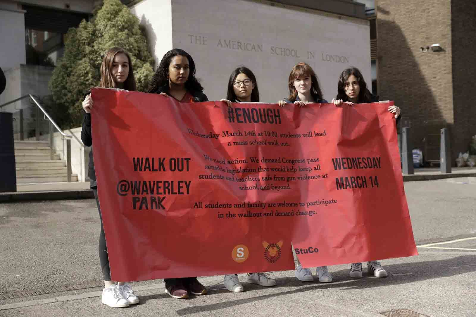 Students, aged 17 & 18, pose for photographs with a banner outside the front of the American School in London, after taking part in a 10am local-time, 17-minute walkout in the school playground, which was attended by approximately 300 students aged 14-18, Wednesday, March 14, 2018. From Maine to Hawaii, students planned to walk out of school Wednesday to protest gun violence in the biggest demonstration yet of the student activism that has emerged in response to last month's massacre of 17 people at Florida's Marjory Stoneman Douglas High School. (AP Photo/Matt Dunham)