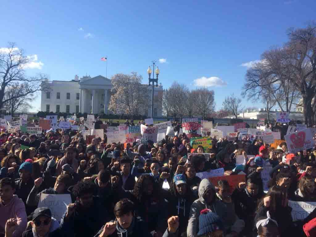 Scores of students sat in complete silence with their backs turned to the White House for 17 minutes beginning at 10 a.m. on March 14. (WTOP/Nick Iannelli)