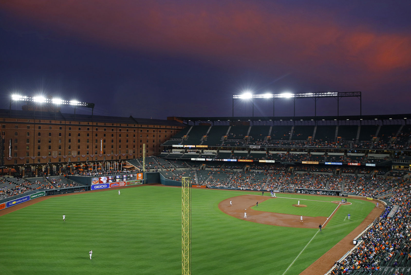 """Camden Yards ushered in the concept of the """"retro park"""" when it opened and is still considered by many to be one of the most beautiful ballparks to watch a game. It ranks as the 25th cheapest stadium with an average cost of $57.83. File. (AP Photo/Patrick Semansky)"""