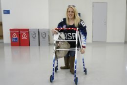 """In this March 11, 2018, photo, Erica Mitchell, a Chicago native and an accomplished player in women's sled hockey, who came to the games as a spectator, poses at the Gangneung Hockey Center in Gangneung, South Korea. Mitchell was one of many people with disabilities who spoke to The Associated Press about accessibility problems at the Paralympic Games in South Korea's rural east, despite what organizers described as a """"perfectly"""" organized event that provided the """"highest level"""" of access. (AP Photo/Kim Tong-hyung)"""