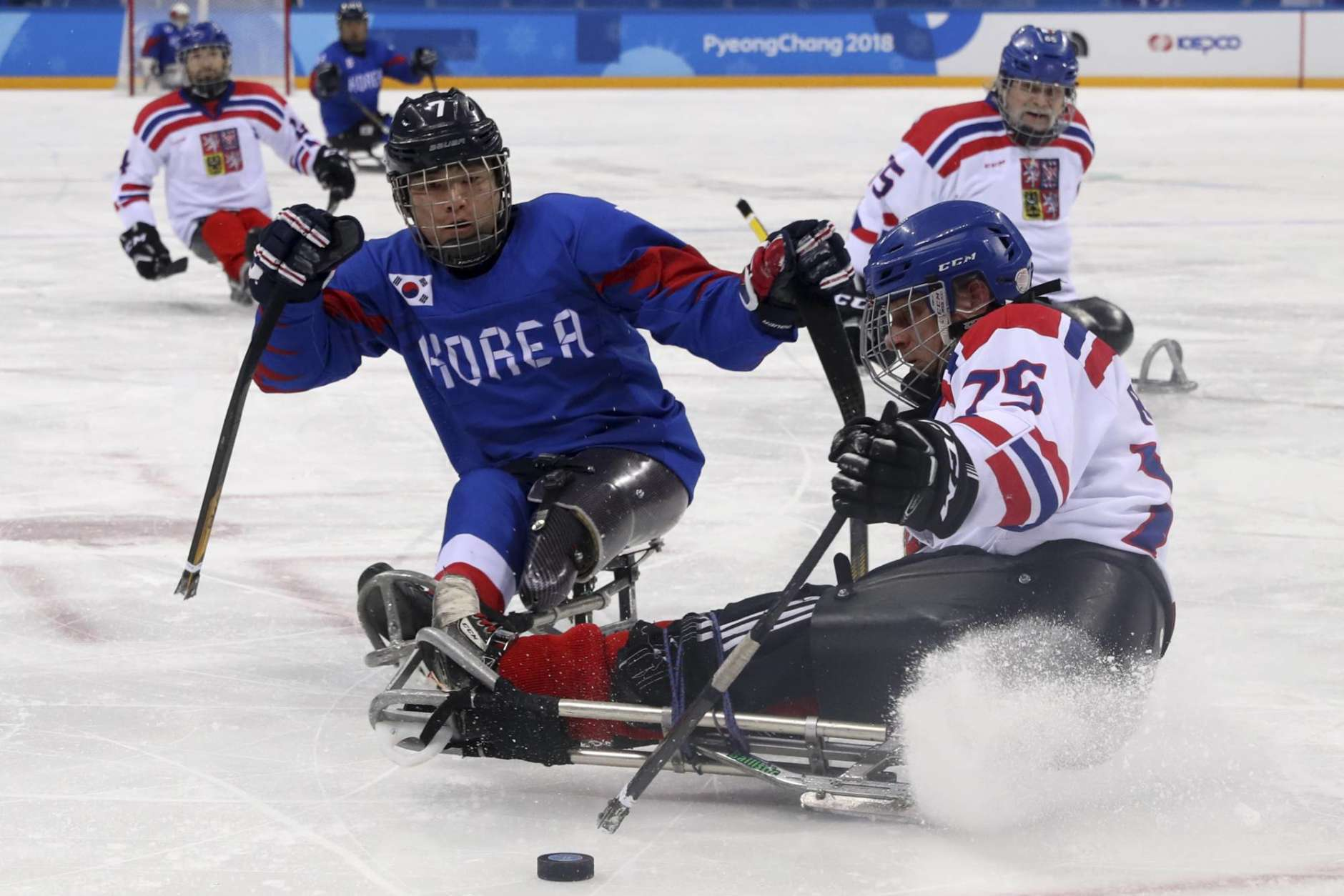 Czech Republic's Jiri Raul keeps the puck from South Korea's Choi Kwang Hyouk during a preliminary Ice Hockey match of the 2018 Winter Paralympics held in Guangneung, South Korea, Sunday, March 11, 2018. (AP Photo/Ng Han Guan)