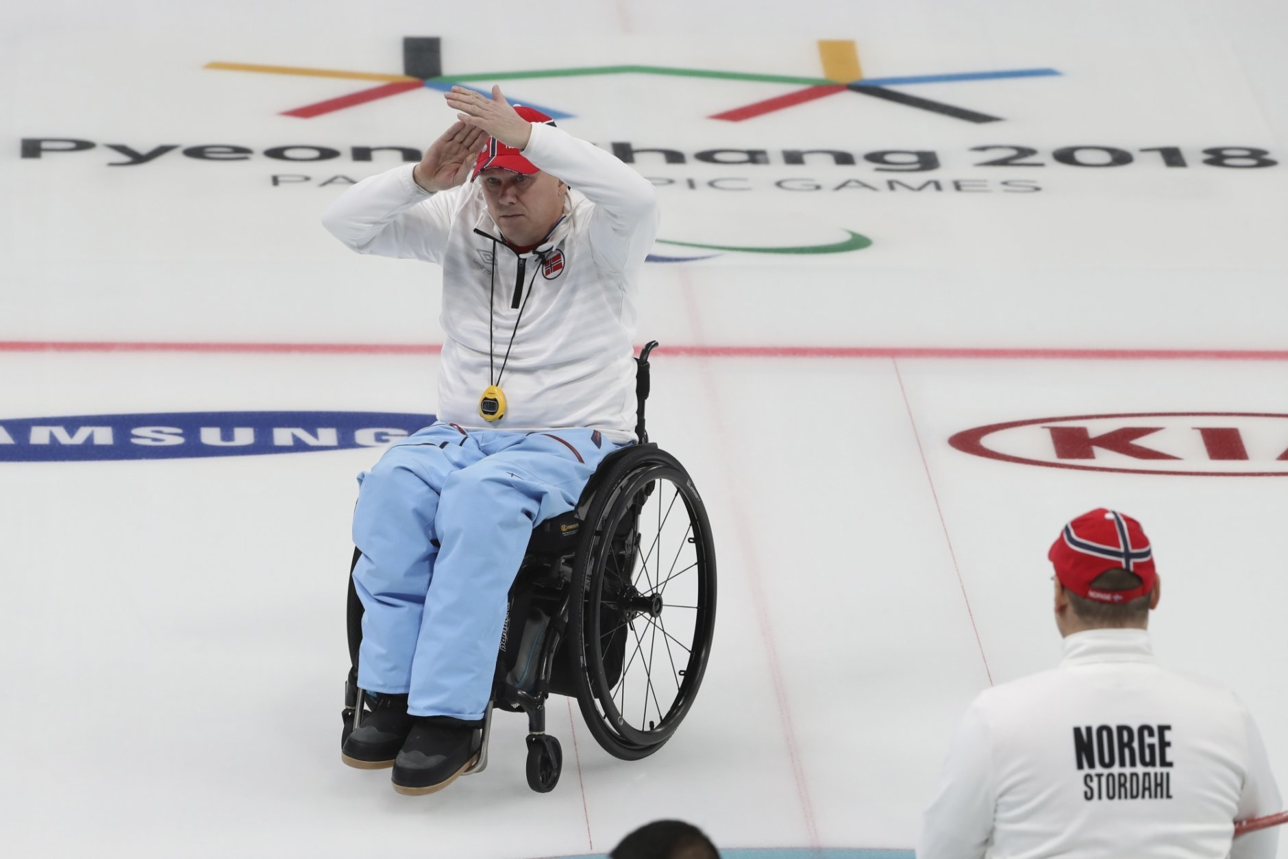 Norway's Rune Lorensten calls for time out during the Wheelchair Curling gold medal match against China for the 2018 Winter Paralympics at the Gangneung Curling Centre in Gangneung, South Korea, Saturday, March 17, 2018.(AP Photo/Ng Han Guan)