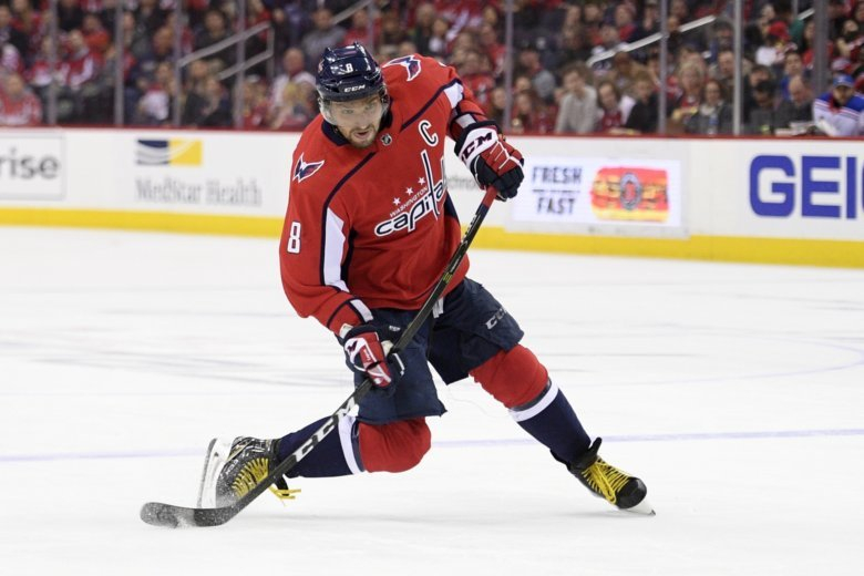 097599713 Washington Capitals left wing Alex Ovechkin, of Russia, winds up for a shot  during the second period of the team's NHL hockey game against the New.