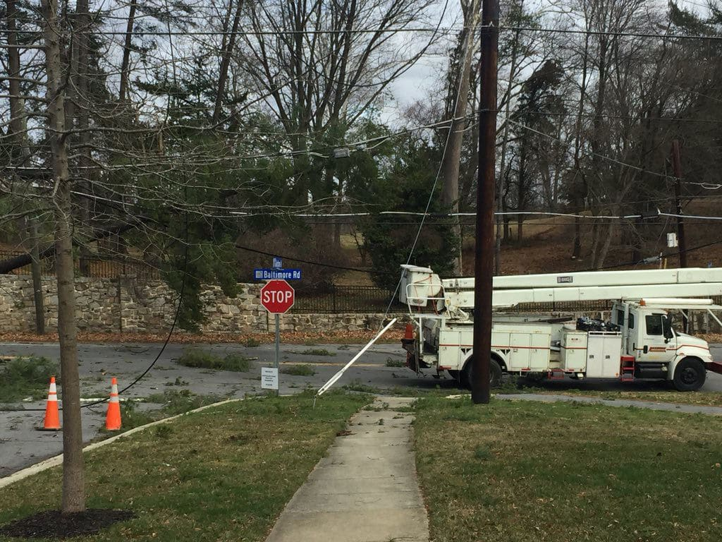 A series of trees fell on Baltimore Road in Rockville, Maryland, while crews were trying to restore power to the area. (WTOP/John Domen)