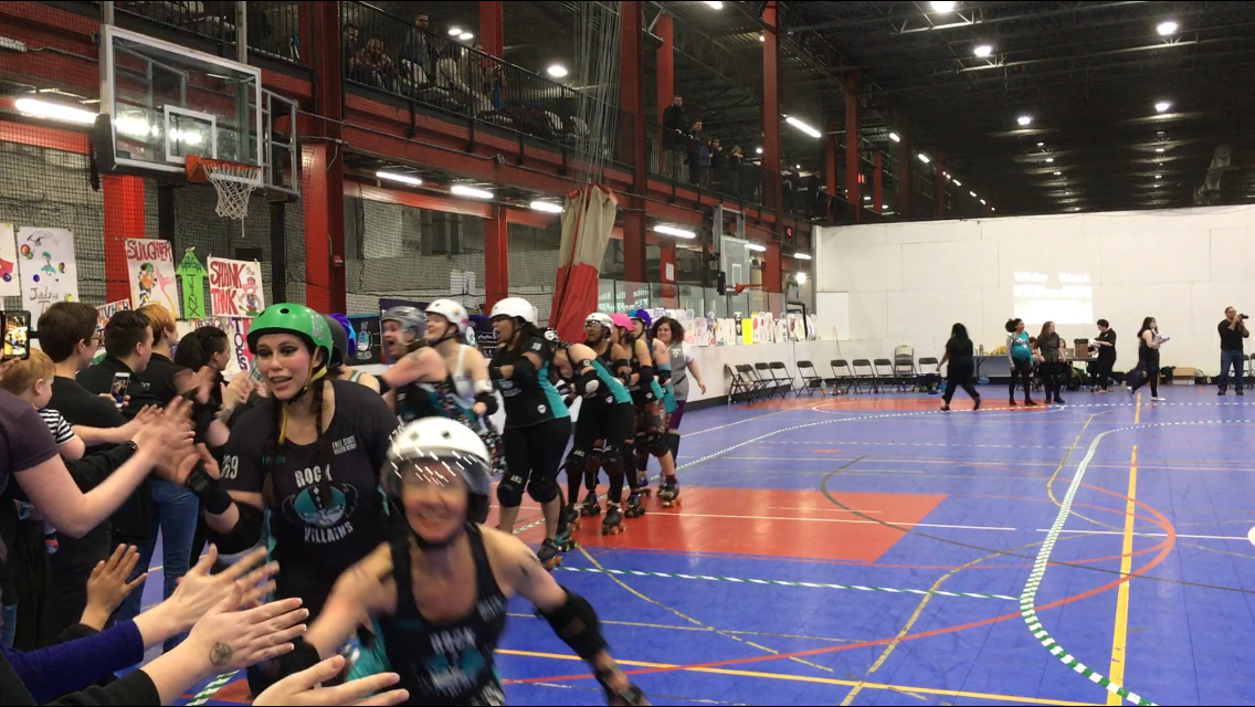 On Sunday, the Free State Roller Derby league pit their travel teams, The Black Eyed Suzies and Rock Villains, against each other in a friendly season-opening bout in Rockville's Sportsplex. (WTOP/Liz Anderson)