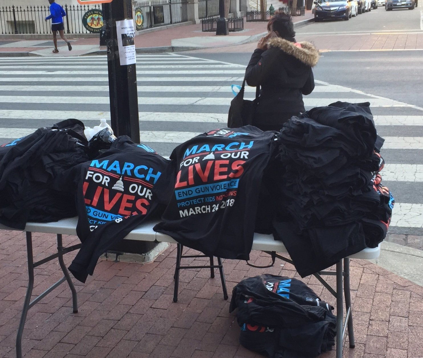 Outside Gallery Place just after 8 a.m., shirts are already being sold. (WTOP/John Domen)
