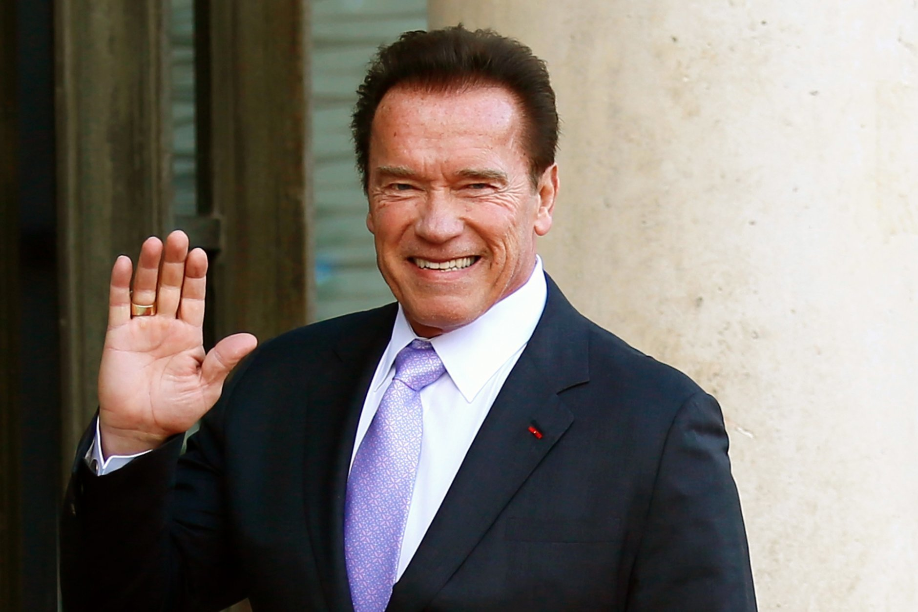 FILE - In this Dec. 12, 2017 file photo, Arnold Schwarzenegger waves as he arrives at the Elysee Palace prior to a meeting on climate change in Paris. Schwarzenegger is recovering in a Los Angeles hospital after undergoing heart surgery. He had a scheduled procedure to replace a pulmonic valve on Thursday, March 29, 2018, according to Schwarzenegger's spokesman. He is in stable condition. (AP Photo/Francois Mori, File)