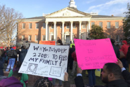 """Many participants wore red, jangled cowbells, and held signs with messages that included """"Don't Gamble With Education"""", """"We Need Step Increases Now"""", and """"Don't Make Me Use My Teacher Voice!"""" (WTOP/Michelle Basch)"""