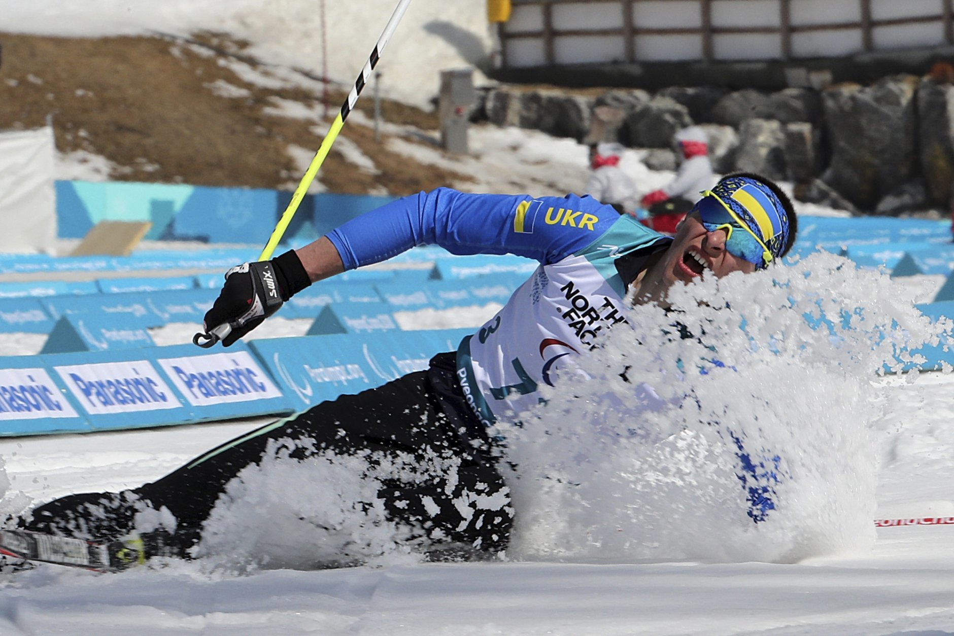 In this March 13, 2018 photo, Ihor Reptyukh of Ukraine collapses after crossing the finish line in the Biathlon Standing Men's 12.5km event at the Alpensia Biathlon Centre for the 2018 Winter Paralympics held in Pyeongchang, South Korea. Reptyukh finished second to clinch the silver medal. (AP Photo/Ng Han Guan, File)