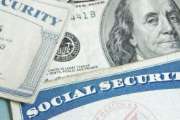 Social security cards and U.S. money - retirement concept. (Thinkstock)