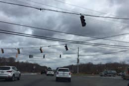 The traffic lights are out and rattling in the wind in Prince George's County. (WTOP/Darci Marchese)