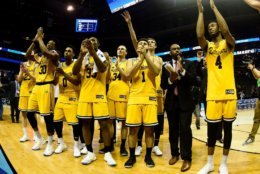 CHARLOTTE, NC - MARCH 18: The UMBC Retrievers thank their fans after losing 50-43 to the Kansas State Wildcats during the second round of the 2018 NCAA Men's Basketball Tournament at Spectrum Center on March 18, 2018 in Charlotte, North Carolina.  (Photo by Jared C. Tilton/Getty Images)