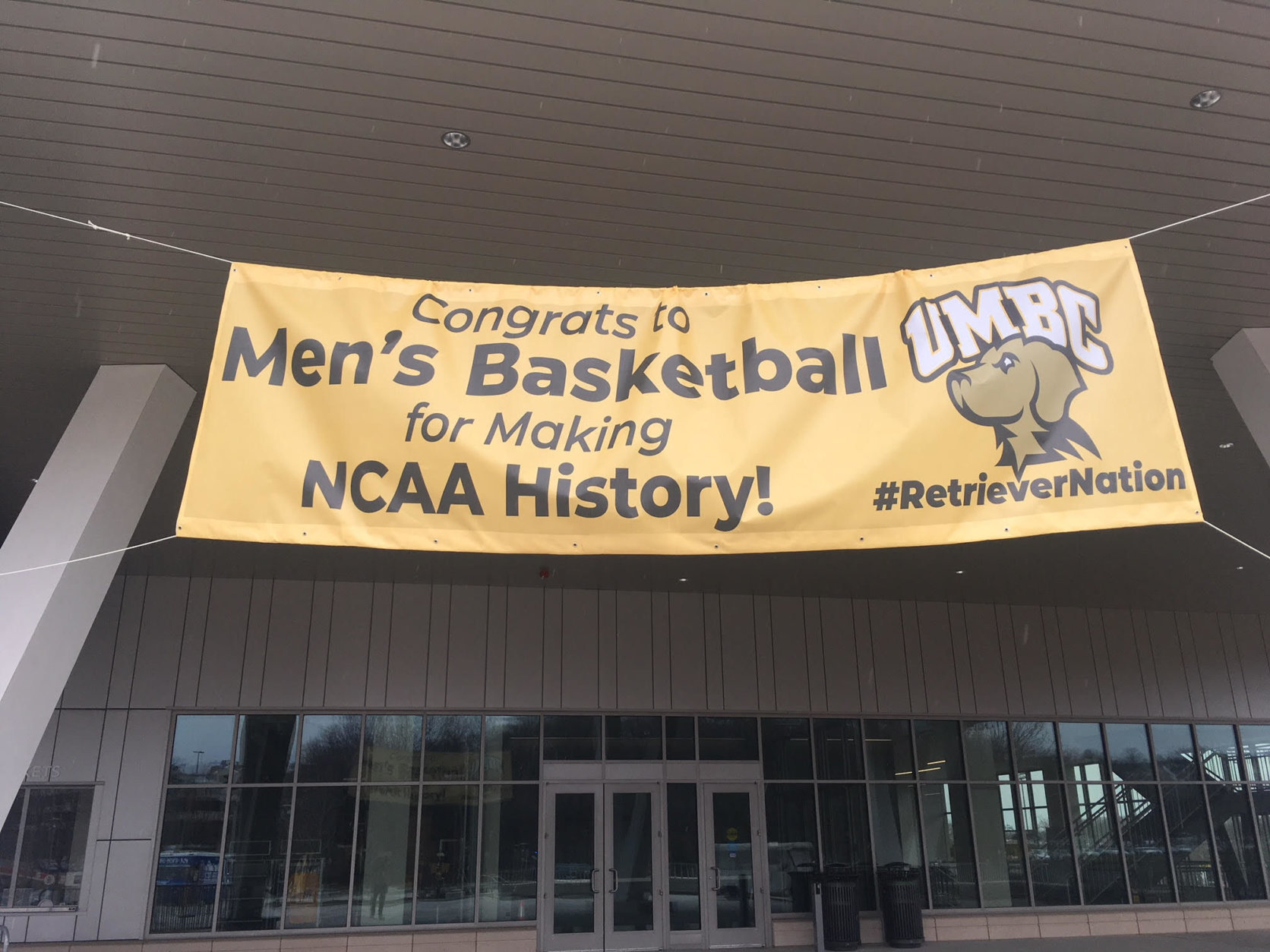 The banner outside the UMBC event center, welcoming the team and students for a celebration Tuesday. (WTOP/Noah Frank)