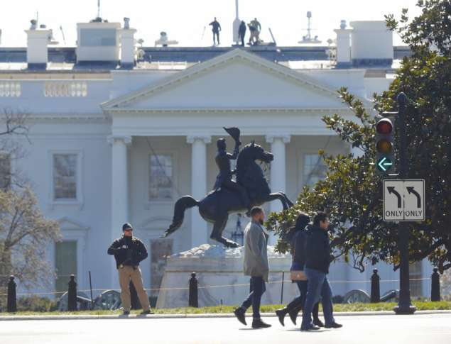 Law Enforcement Officer Stands At The Entrance To Lafayette Park Across  From The White House In Washington, After The Area Was Closed To Pedestrian  Traffic, ...