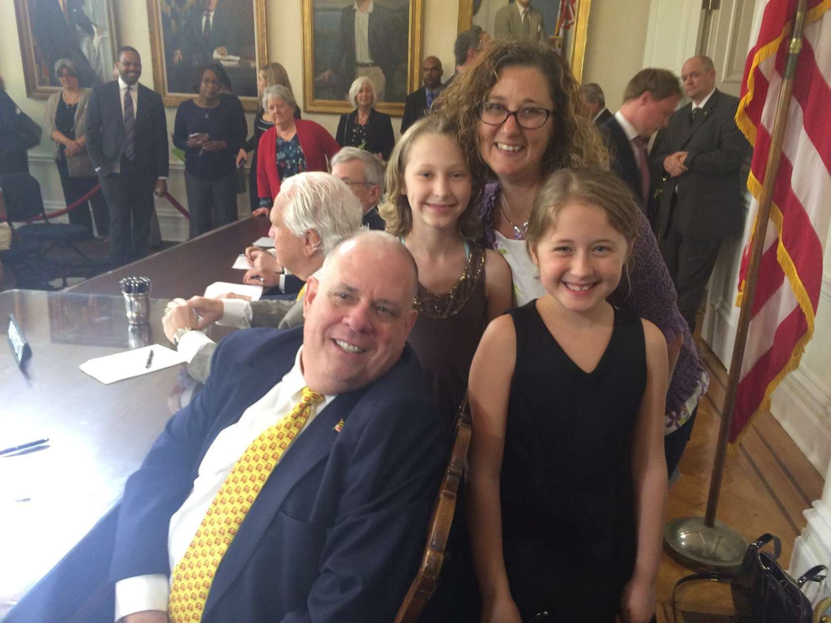 "The program that the Maryland State Department of Education is adopting is an outgrowth of ""Peyton's Law,"" signed by Gov. Larry Hogan in 2017. Peyton (in black) attended the signing. (Courtesy Lynn Schaeber)"