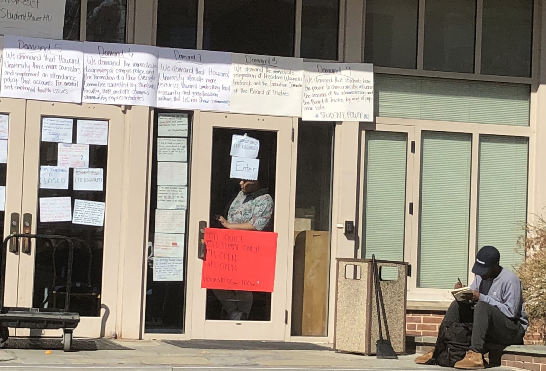 Protesters' demands are posted outside Howard University's Mordecai Wyatt Johnson Administration Building, which students have occupied since a sit-in began Thursday. (WTOP/Melissa Howell)