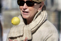 Martha Stewart tosses a lemon into the air outside of her home in Katonah, N. Y., Friday, March 4, 2005. Stewart refered to the saying about turning lemons into lemonade and said she was going inside to make hot lemonade. Stewart must spend the next five months in home confinement here at her $16 million New York estate.  (AP Photo/Ed Betz)
