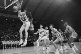 """FILE - In this March 19, 1966, file photo, Kentucky's Thad Jaracz (55) and Texas Western's David Latin (42) reach for a rebound during the first period of the NCAA men's baksetball championship game in College Park, Md. Other Kentucky players shown are Tommy Kron (30) and Larry Conley (40). Fifty years ago, Texas Western started five blacks–Willie Worsley, Orsten Artis, Bobby Joe Hill, David """"Big Daddy"""" Lattin and Harry Flournoy–against Kentucky in the game. Today, after reading historical recaps and watching movies, people tend to think it was an immediate watershed moment in sports and civil rights. It wasn't. (AP Photo/File)"""