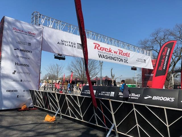Crowds watch for runners at the finish line. (WTOP/Melissa Howell)