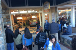 Shoppers gather to see a car that crashed into a store in Rockville, Maryland. (Courtesy Dave Kremnitzer)