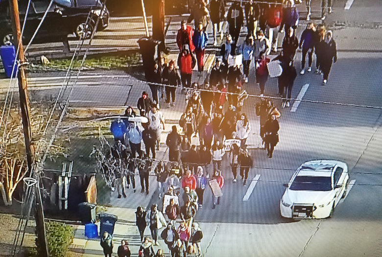Photo shows students who walked out of school