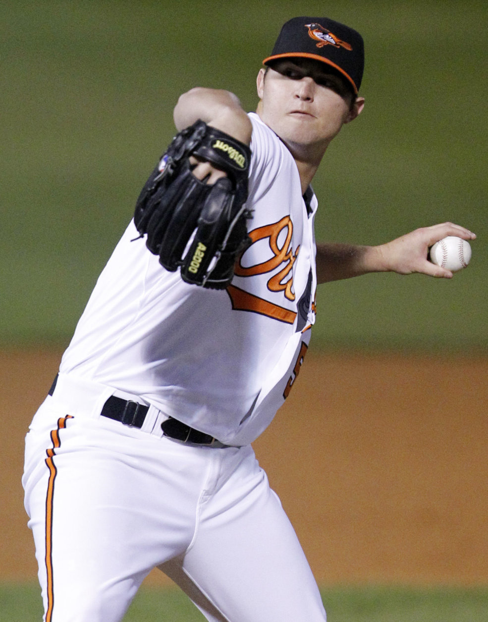 Baltimore Orioles pitcher Zach Britton throws in the second inning during a spring training baseball game against the New York Yankees in Sarasota, Fla., Monday, March 7, 2011.  (AP Photo/Gene J. Puskar)