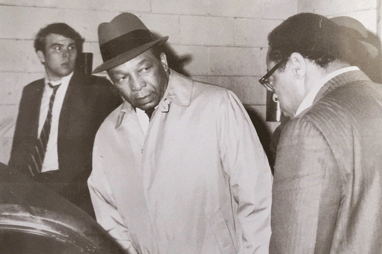 Mayor Walter E. Washington (center) prepares for a near-midnight tour of the damage after window-breaking, looting and arson broke out late in the evening April 4, 1968 after the assassination of Dr. Martin Luther King in Memphis. Paul Delaney (in foreground) hopped in the back of the mayor's car for a backseat view of history as the nation's first black mayor surveyed the destruction in the city. (Courtesy Paul Delaney)Mayor Walter E. Washington (center) prepares for a near-midnight tour of the damage after window-breaking, looting and arson broke out late in the evening April 4, 1968 after the assassination of Dr. Martin Luther King in Memphis. Paul Delaney (in foreground) hopped in the back of the mayor's car for a backseat view of history as the nation's first black mayor surveyed the destruction in the city. (Courtesy Paul Delaney)